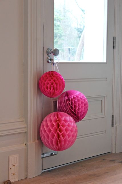 honeycomb tissue balls strung on door